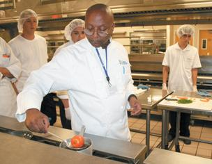 Chef Bill Collins works with Mesa Community College culinary students at the program's former home at the East Valley Institute of Technology. The program temporarily is housed at Dobson High School, but is looking for a permanent home.