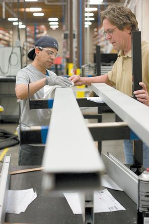 Mario Velasquez, left, and Tom Peganoff inspect recently milled parts at Dirtt Environmental Solutions' new Phoenix factory.