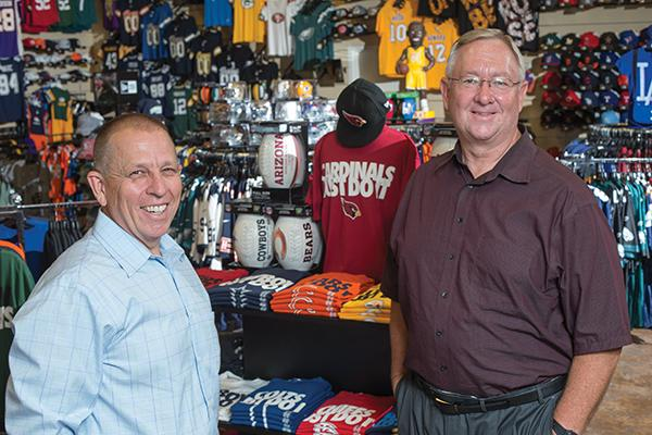 Just Sports co-owners Kelly Roberts, left, and Kevin Palmer said game-day sales were up 60 percent at their newly expanded Westgate store Aug. 30, when the Arizona Cardinals played the Denver Broncos in a preseason match-up in Glendale.