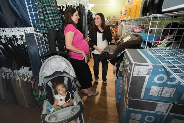 Mesa resident Jennifer Riggs (with her daughter, Trinity, 1) shops for her second child with Dianna Echeverri of Hello Baby Maternity Concierge.