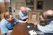 From left, customer James Verbic, General Manager Marc Israel and President David Goldstein discuss the collateral value of a painting at Biltmore Loan and Jewelry in Scottsdale.