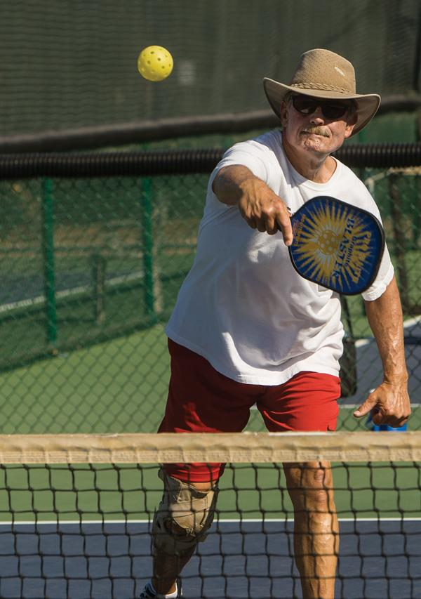 Larry Gleeson of Pebblecreek in Goodyear enjoys a game of pickleball. These courts are among the popular amenities at active-adult communities.