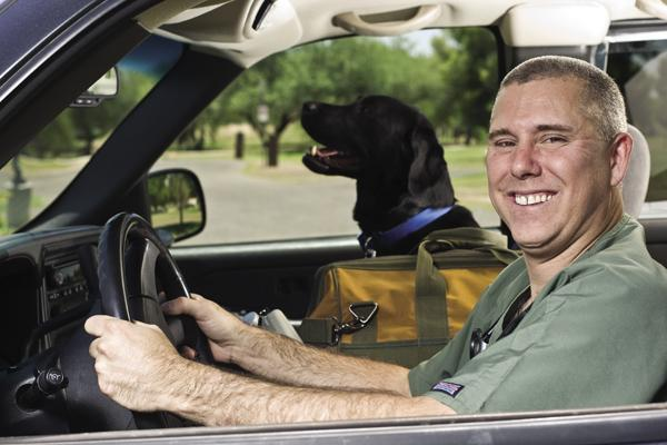 Dr. Anthony Gilchrist (pictured with his black Labrador, Blue) operates a mobile veterinary business that offers everything from annual checkups to euthanasia. He says not having a physical office allows him to charge less for his services.