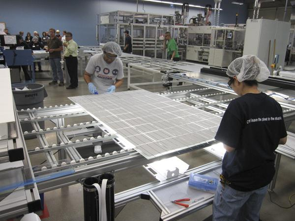 A solar panel goes through the process at the now-closed Solon Corp. manufacturing facility  in Tucson. Solon remains in business in Arizona despite shutting down its manufacturing. It turned to developing solar power plants and now is expanding across the country.