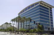 US Airways will keep workers at its Tempe offices after the merger, but questions remain as to how many.