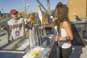Shannon Strieter works at a vending booth at Salt River Fields on Feb. 26. The stadium has been a huge draw for Cactus League fans, often outselling its listed capacity and providing vendors in and near the stadium with a windfall.