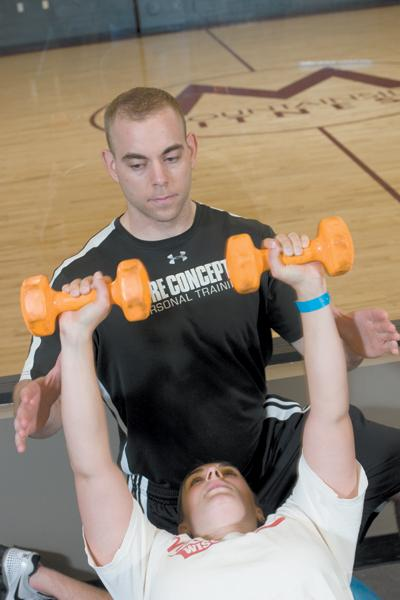 Mountainside Fitness member Christy Smith works with personal trainer Dustin Harth.