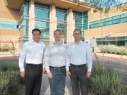 Cresa Partners' Gary Gregg, left, and Jason Wery, right, with Fender Musical Instruments Group's Mark Van Vleet, center, at North Scottsdale's Perimeter Center, where Fender is slated to move its  headquarters in February.