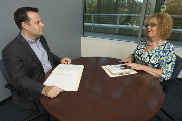 Andy Ernst, Phoenix regional vice president of Robert Half International, evaluates Colette Nordstrom's resume.