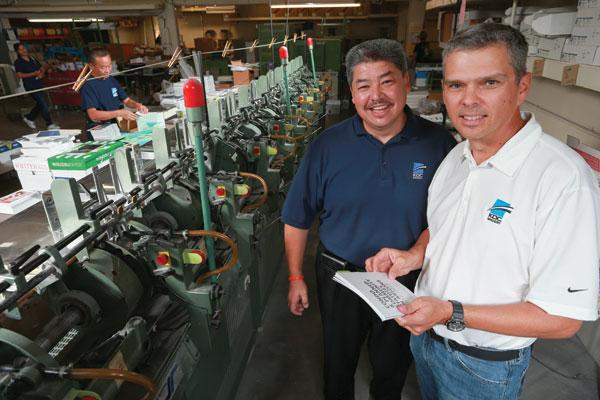KDC Bindery owner Doug Hoffman, right, bought his Tempe bindery business in 2007. The process of buying and selling a company changed dramatically for him since he first bought a photography shop 28 years ago. He is pictured with his general manager Jack Fisher.