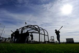 Baseball players practice their swing at Camelback Ranch, one of the newer  spring training facilities for teams in the Cactus League.