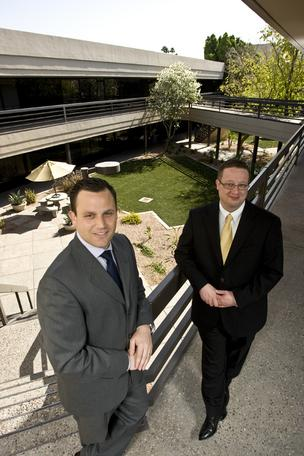 Todd Noel, left, and Pete O'Neil of Colliers International say office tenants are making a flight to quality, moving up to Class A properties, where many landlords are cutting rates to fill space left vacant from the economic slowdown.