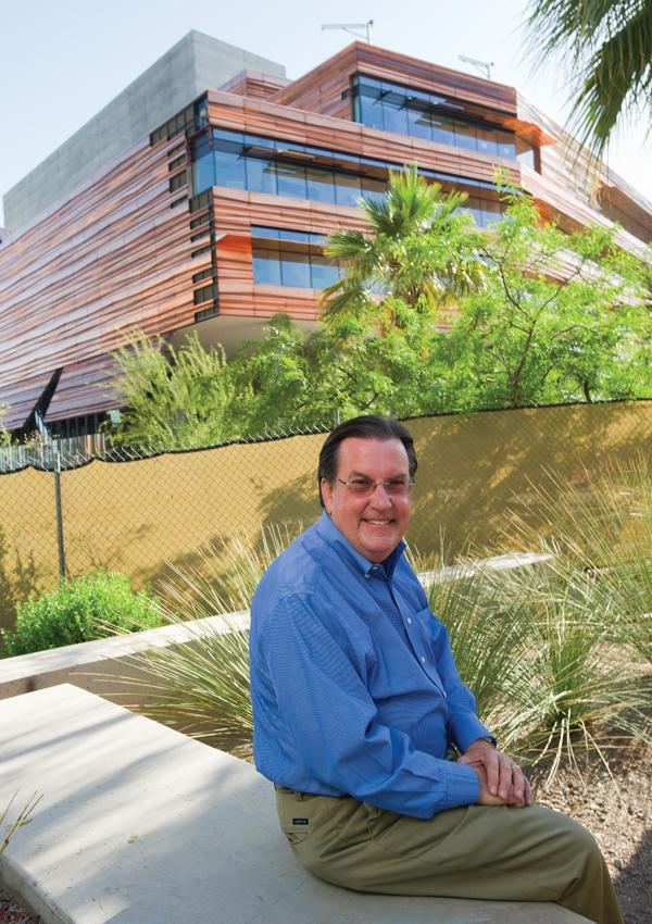 Grady Gammage Jr. says the University of Arizona College of Medicine–Phoenix is a perfect example of cooperation between Phoenix and Tucson. Behind him is the UA Health Sciences Education Building, set to open soon as part of that downtown Phoenix campus.