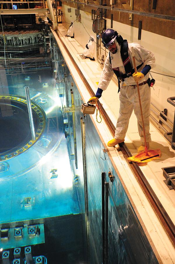 A worker at Palo Verde Nuclear Generating Station checks radiation levels near a reactor during a recent refueling.