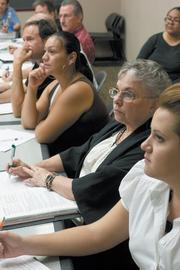 Lynne Broshears, second from right, attends a free resume-writing class at Maricopa Workforce Connections. The former school bus driver hopes to transition into a career as a receptionist or library aide.