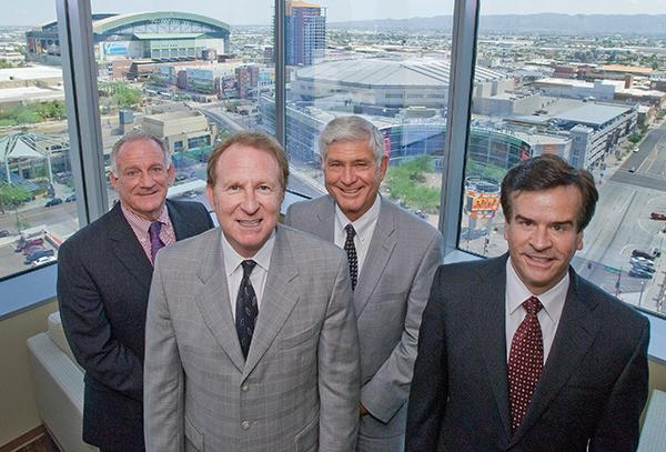 Phoenix-based Western Alliance Bancorp. recently purchased Western Liberty Bancorp. of Las Vegas for $55 million. Executives are eyeing further acquisitions in the Southwest as the economy improves. Pictured, from left, are Ed Zito, president of Alliance Bank of Arizona; Robert Sarver, chairman and CEO of Western Alliance Bank Corp.; James Lundy, CEO of Alliance Bank; and Dale Gibbons, executive vice president and CFO of Western Alliance Bank Corp.