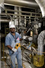 A Palo Verde worker uses a teletector to measure radiation.