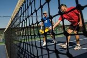Len Seif, left, and Gary Page play pickleball at Pebblecreek, which recently added 12 new courts to keep up with demand from active adult residents.