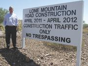 John Graham, president and CEO of Sunbelt Holdings, is attempting to make his company's Vistancia community more accessible by building a 1-mile stretch on Lone Mountain Road, connecting the development to Loop 303.