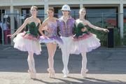 From left, dancers Sarah Chisolm, Michelle Vagi, Slawomir Wozniak and Beau Campbell pointe at the construction site of Ballet Arizona's new $10 million facility. Below, Campbell tips a hard hat.
