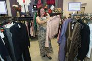 Pat Keene, a Fresh Start program participant who once operated her own business, adjusts clothing on the racks at the foundation's retail store.