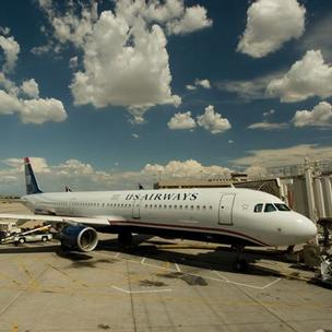 US Airways Group Inc., the dominant airline at Philadelphia International Airport, reports a slight dip in traffic in May.