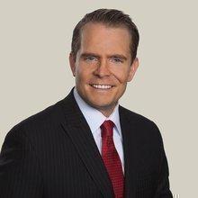 Travis J. Leach
