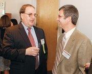 Chuck Leyh, left, of Enterprise Bank chats with Doug Lockard of Kuzneski & Lockard Inc. Leyh is a Diamond Awards winner.