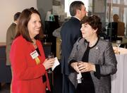 Mary Sleighter, left, of Sisterson & Co. LLP mingles with Sadie Kroeck of Peoples Natural Gas.