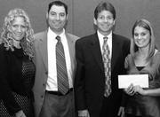 Kathryn Spitz Cohan, left, Jonathan Rosenson and Dr. Bernard Newman presented Jodie White with the 2008-09 check from United Jewish Federation's Central Scholarship & Loan Referral Service, which is managed by Jewish Family & Children's Service.