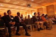Entrepreneurs (from back left) Steven Radney, Logan Powell, Kariithi Kilemi, Dan Dwire, Justin Endler, Nicholas McClay and Corissa McClay await their turn on stage.
