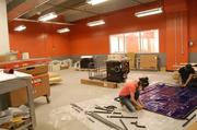 Some members of the newly trained Pittsburgh TechShop staff setting up the woodworking room at the Bakery Square facility. The staff recently returned from the California where they were getting trained on equipment.