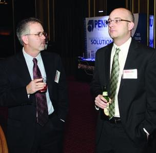 Ashley Wellner, left, and Dave Holmes of Aerotech Inc. attend the Manufacturer of the Year Awards celebration Thursday, Dec. 6, at the Omni William Penn Hotel, downtown. Aerotech was one of the honored companies.