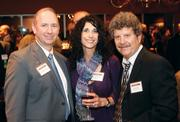 First National Bank of Pennsylvania's Jeffrey Martin, left, networked with Terri Sokoloff of Specialty Bar & Restaurant Brokers and Specialty Group's Ned Sokoloff  at the Pittsburgh Business Times' 2012 Book of Lists reception Jan. 23 at the Rivers Club in Downtown Pittsburgh