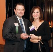 Chris Chelli of Allegheny Valley Bank and Jackie Hooper of Third Planet Global Creative at the Pittsburgh Business Times' 2012 Book of Lists reception Jan. 23 at the Rivers Club in Downtown Pittsburgh.