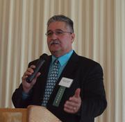 Andrew Corfont of Community Bank addresses the audience at the Business for Breakfast event from the Pittsburgh Business Times held Wednesday, March 21, 2012, at the Southpointe Golf Club.