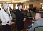 Shelley Shaw, left, and Amy Dubin, both of Campos Inc., speak with Dave Yunghans, regional development director of Constant Contact, at the Business for Breakfast event from the Pittsburgh Business Times held Wednesday, March 21, 2012, at the Southpointe Golf Club.