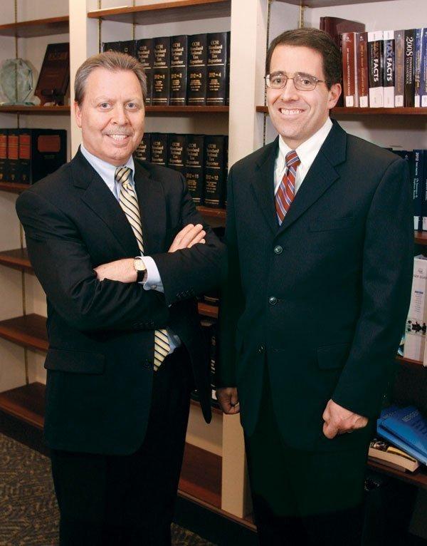 Fox Rothschild LLP office managing partner William Stang, left, and partner Jay Marinstein.