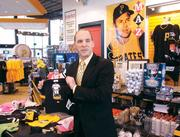 ARAMARK General Manager Steve Musciano highlights new merchandise available this season at the Pirates' Majestic Team Store in PNC Park during a media event April 3, 2012.