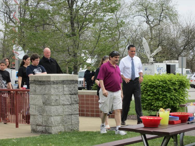 GOP presidential candidate Mitt Romney and Timothy Ditoro lead the way Tuesday afternoon in back of the Bethel Park Community Center for a roundtable on tax and other issues ahead of next Tuesday's Pennsylvania primary.