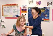 Brentwood Middle School seventh-grader Abbey Myers, left, takes a whiff of perfume made by Alithia Kephalogianis in a fragrance lab experiment led by teacher Pam Belczyk. The school, which is in the Brentwood Borough School District, ranked 71st on the eight-grade list and 72nd on the seventh-grade list.