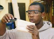 East Allegheny Junior/Senior High School senior Carlos Sloan works on a project in Ed Czapor's industrial arts class. The school is in the East Allegheny School District, which ranks No. 91 on the honor roll list of local public districts.
