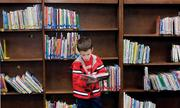 Central Elementary School (K-5) first-grader Roman Gardner picks a Buzz Lightyear book to read in the school's library. The school is in the Elizabeth Forward School District, which ranks No. 47 on the honor roll rank of local public districts.