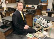 Mt. Lebanon School District Superintendent Timothy Steinhauer poses in one of the school's current biology labs, which will be replaced with updated classrooms when current facility construction is completed. The school district ranked third on the honor list for local public districts.
