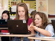 Carson Middle School teacher Kathie Salpietro assists a student in her seventh grade English class. Students were using netbooks to do research for the class lesson. The school, which is in the North Allegheny School District, ranked fourth on the eighth-grade list and eighth on the seventh-grade list.