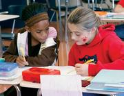 Francis McClure Intermediate School (4-6) fourth-graders Shaeona Ellis, left, and Ricki Jones partner up while reading October 7, 2010 in Rob Pupich's class. The school is in the McKeesport Area School District, which ranked No. 99 on the honor roll rank of local public districts.