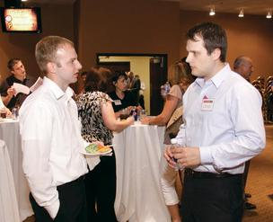 Aerotek's Andrew Miller, left, chats with Newton Consulting LLC's Josh Newton at the BizMix event at PNC Park May 29, 2012.