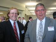 Todd Fleming, left, and Bob Perkins, both of Precision Defense Services in Irwin, at the Pittsburgh Business Times' Corridors of Opportunity event Monday, June 10, 2011, at the Westinghouse Electric Co.'s headquarters in Cranberry Township.