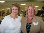 Cindy Cooney of C to It LLC, left, and Carla Sims of Colortone Staging & Rentals at the Pittsburgh Business Times' Corridors of Opportunity event Monday, June 10, 2011, at the Westinghouse Electric Co.'s headquarters in Cranberry Township.