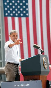 President Obama waves to the crowd at an event held at Carnegie Mellon University of Friday, July 6.